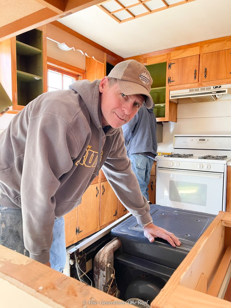 Jim removing the old kitchen appliances in 1960s kitchen