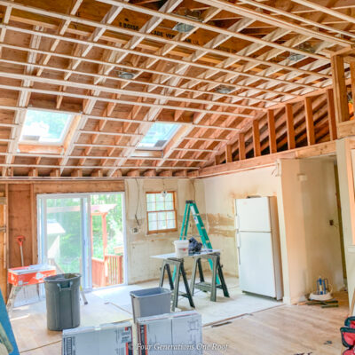 Adding a beam to a load bearing wall to open up kitchen