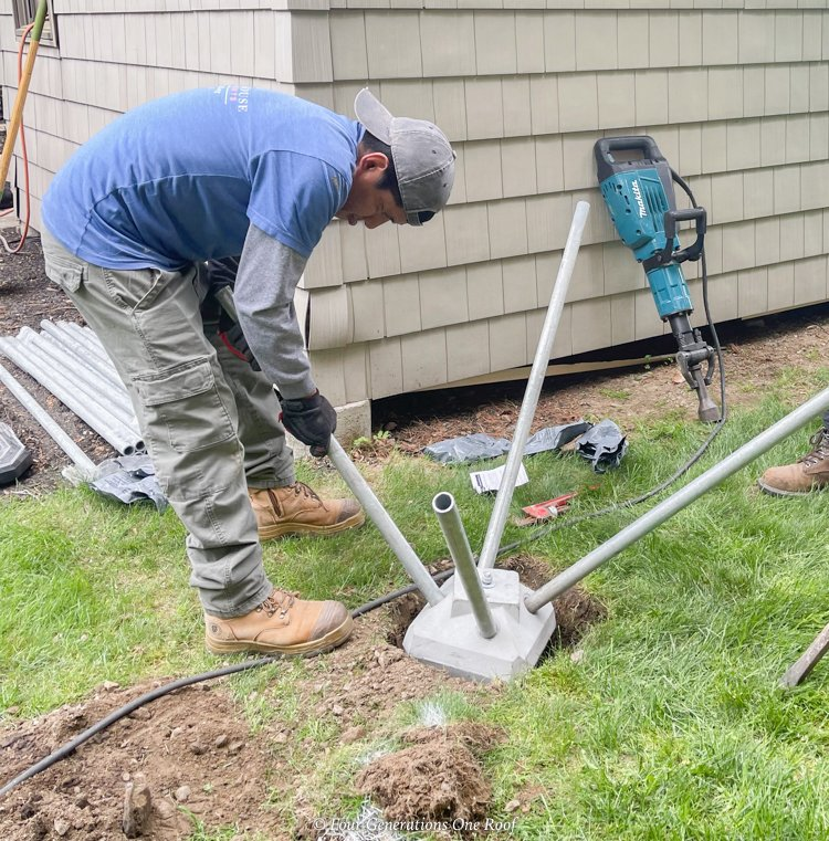 diamond pier cement block footing in ground with metal pins