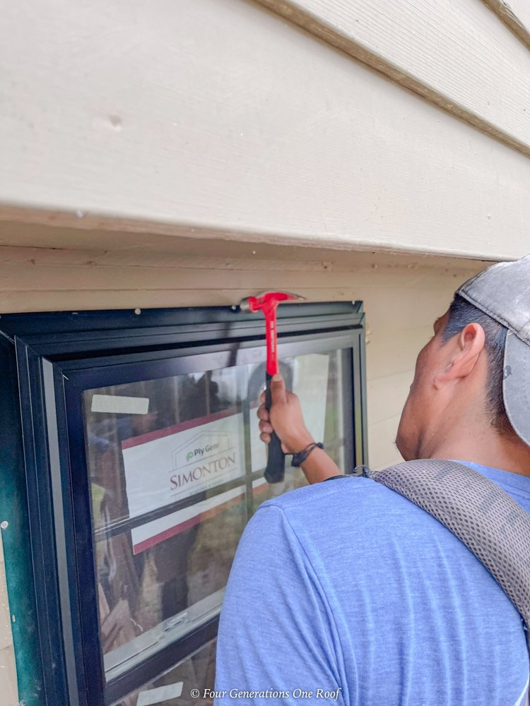 installing black windows with 1 1/2 inch nails