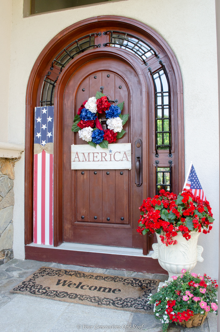4th of July brown arched front door wreath, flag, America, front door and patio 4th of july decorating ideas